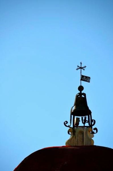 Detail on clock tower. weather vane.
