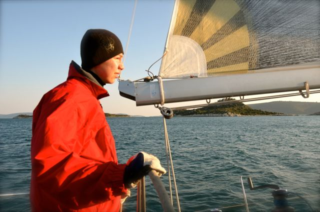 Robert's son steering the sailboat - Croatia