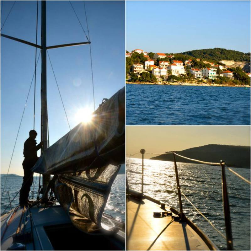 sailboat: main lifting sail, Croatian seaside town, and sailboat's railing