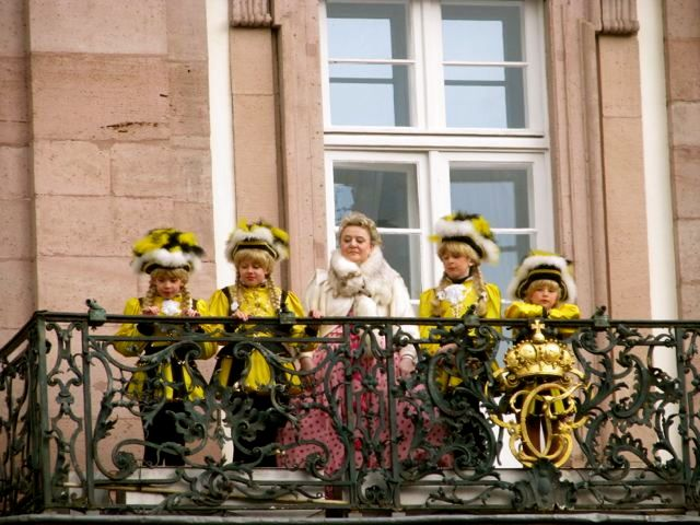 woman and children on balcony in Heidelberg Germany