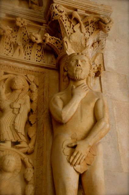 Adam statue inside the portal of the St. Lawrence Cathedral in Trogir, Croatia