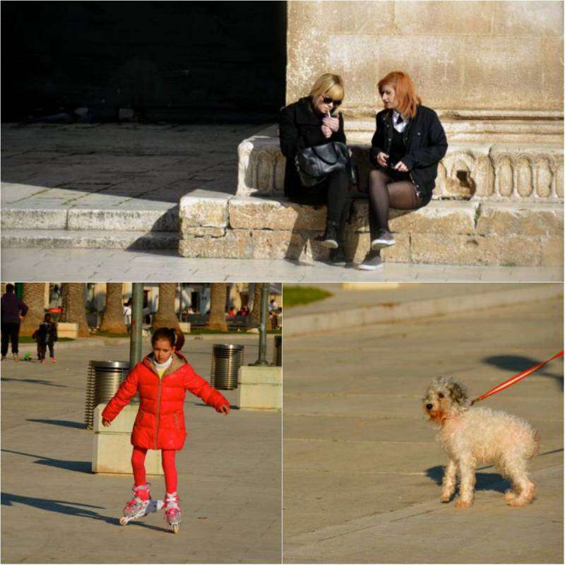 ladies smoking, child rollerskating, dog in trogir