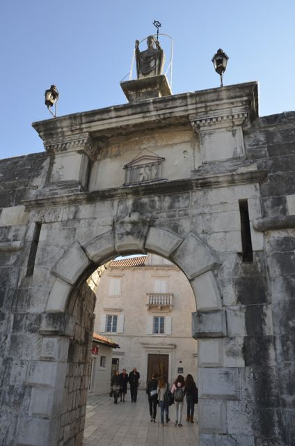 Trogir's northern gateway with statue on top