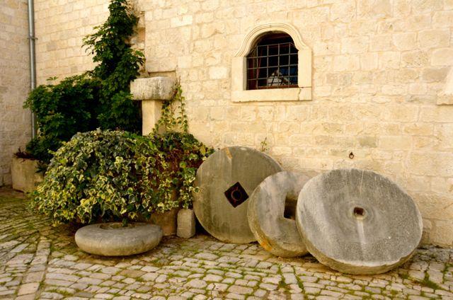 Olive millstones in Trogir courtyard
