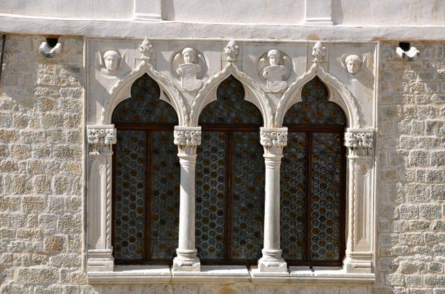 Cipiko Palace's decorative work over windows - Trogir