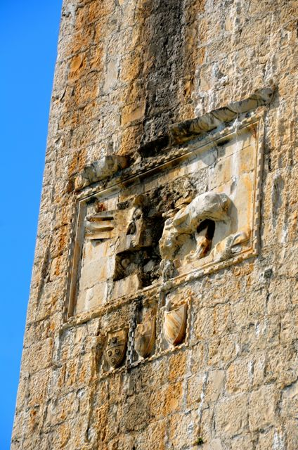 The Kamerlengo Fortress Tower, with a destroyed winged lion frieze