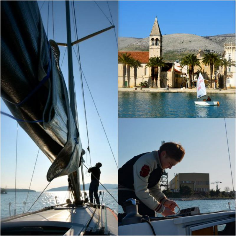 lifting the sail on a boat in Trogir, Croatia