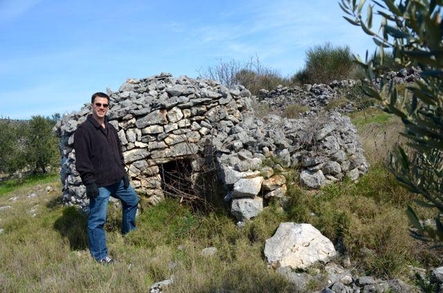 shepherd's stone shelter in croatian countryside