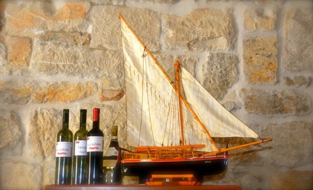 model sailboat and wine bottles in Croatia
