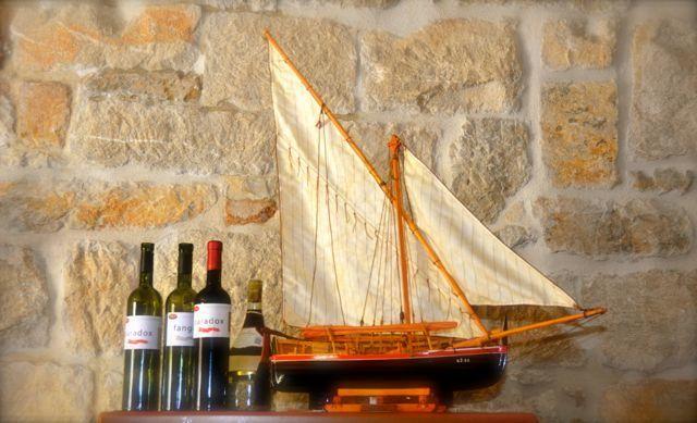 model sailboat and wine bottles in Croatia