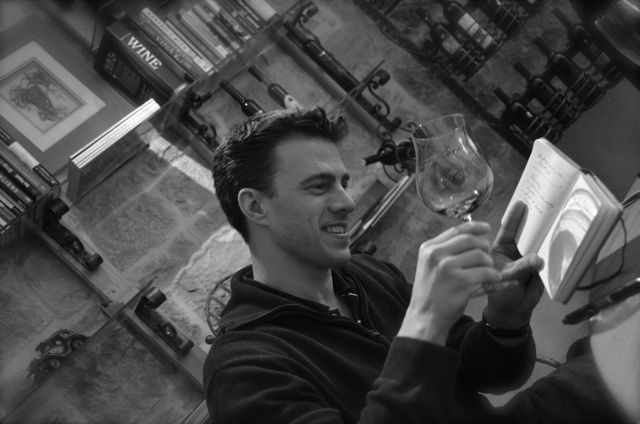 Shawn examining wine color in glass in Croatian wine bar