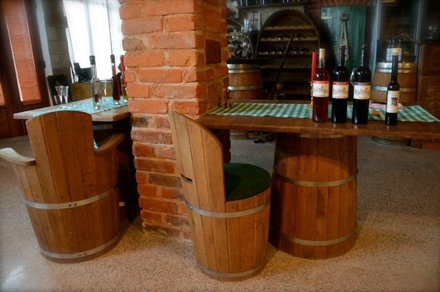 restaurant table and chairs with wine on table