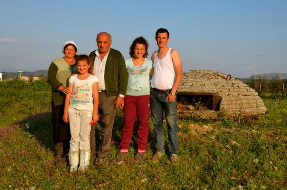 albanian family standing next to bunker