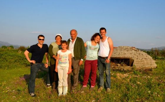 albanian family and shawn beside bunker