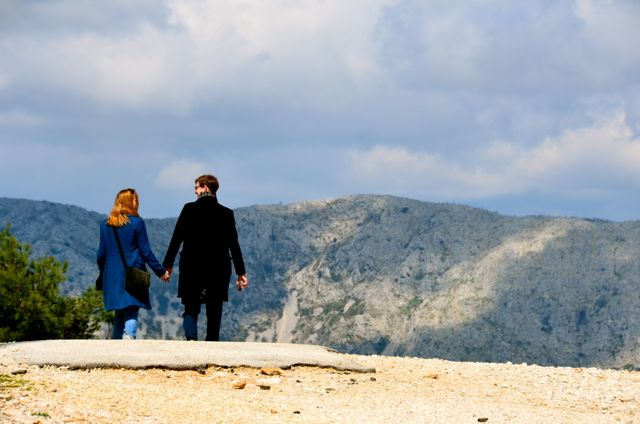 couple walking atop mount srdj
