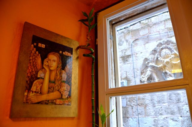 artwork and window of Dubronik's Nishta restaurant
