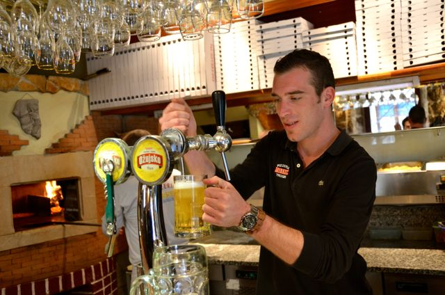 A man pours a draft beer