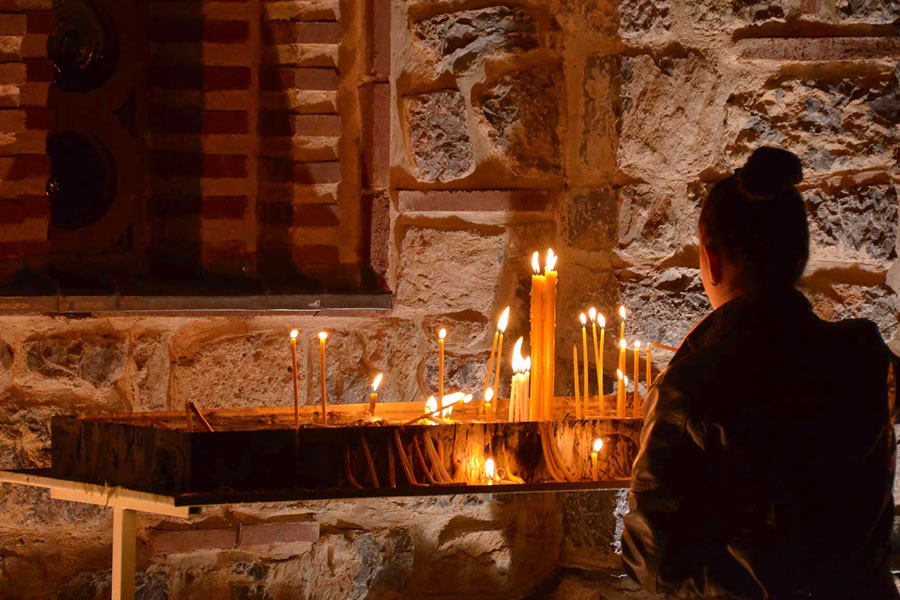 A woman lights a candle at Orthodox Easter Celebrations in Ohrid, Macedonia.