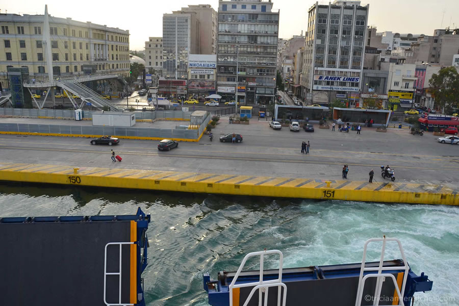 A ferry leaves the Port of Piraeus in Athens.