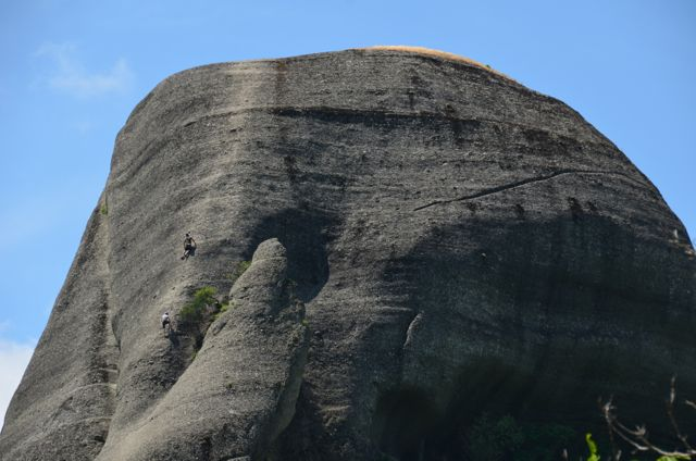 rock climbers scale formation in meteora greece