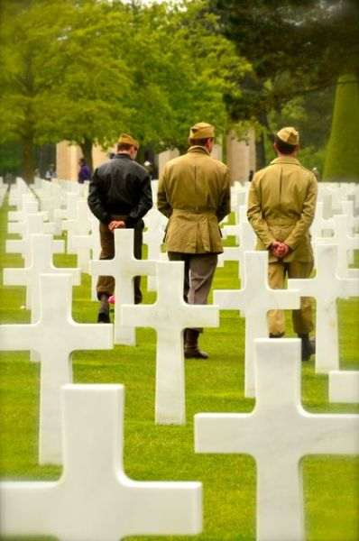 re-enactors at american cemetery in normandy for the 2013 anniversary
