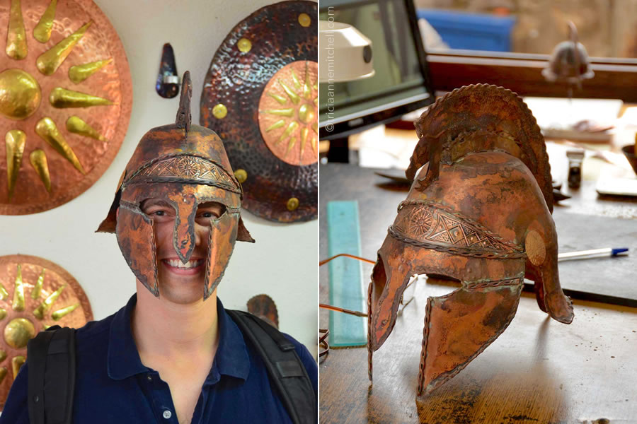 A man wears a copper and brass mask inside a souvenir shop in Ohrid, Macedonia.