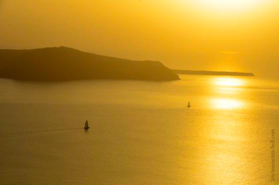 santorini-sunset-and-two-sailboats