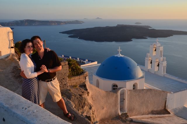 Standing beside Santorini's iconic church at sunset1