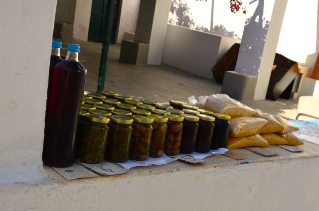 Local products for sale: olives, capers, and Santorini Fava.