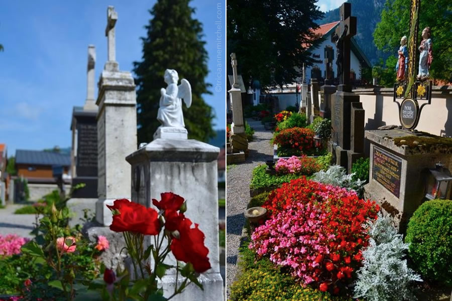 Headstones and flowers in Oberammergau, Germany's St. Peter and Paul Cemetery.