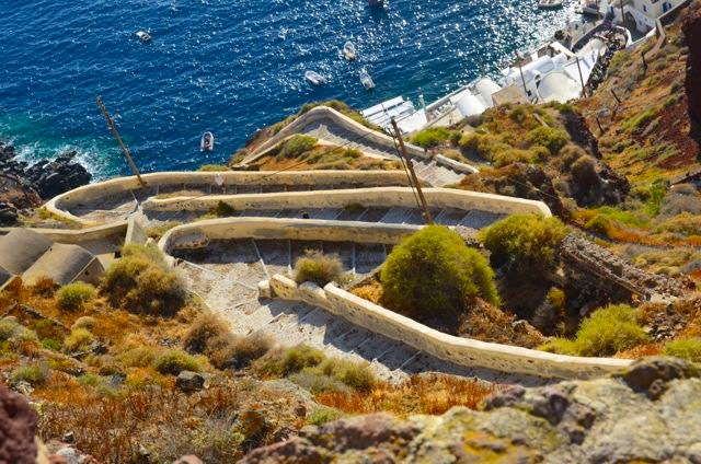 Footpath from the old fishing village of Amoudi Bay below to Oia.