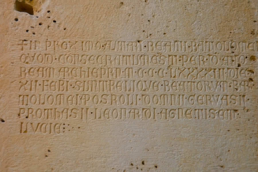Writing carved into Jupiter Temple Wall Split