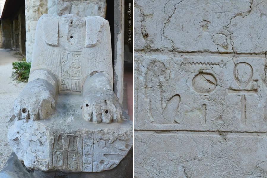 Egyptian headless sphinx decorated in hieroglyphics