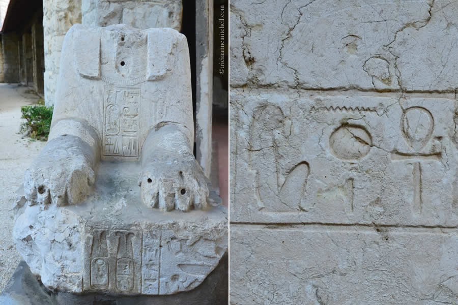 Egyptian headless sphinx decorated in hieroglyphics