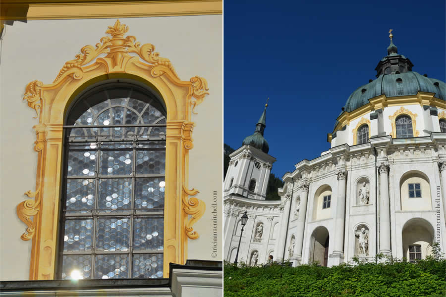 A close-up of the Ettal Monastery's architecture. On the left, a window with yellow trim, and a window with a sun's reflection. On the right, the dome and tower of the white monastery.
