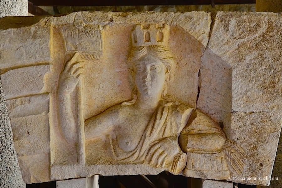 An ancient decoration of a woman wearing a crown