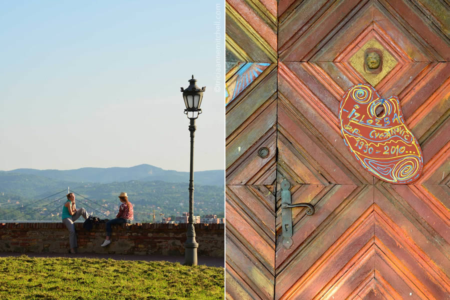Two women sit on a wall of the Petrovaradin Fortress (left). On right, the ornamental door of an art gallery inside the Petrovaradin complex.