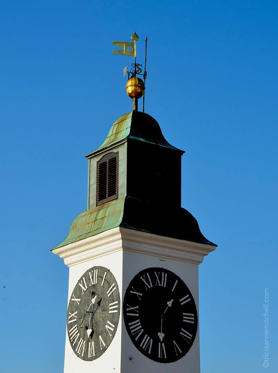 A close-up of the Petrovaradin Clock Tower in Novi Sad, Serbia. It's known for having swapped hour and minute hands on its clockface.