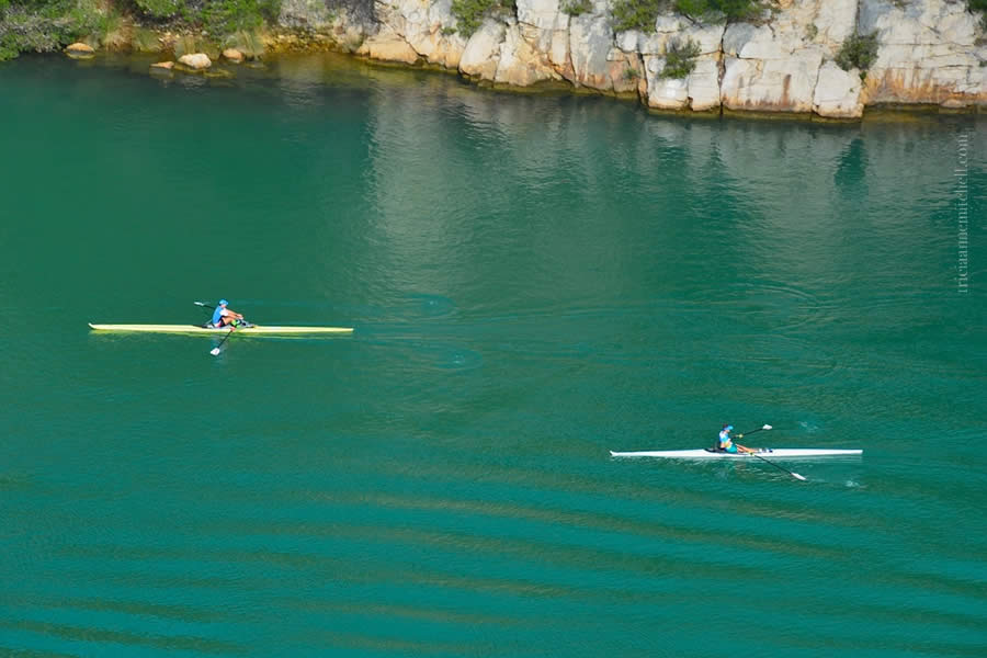 Two men row kayaks on the Krka River in Croatia.