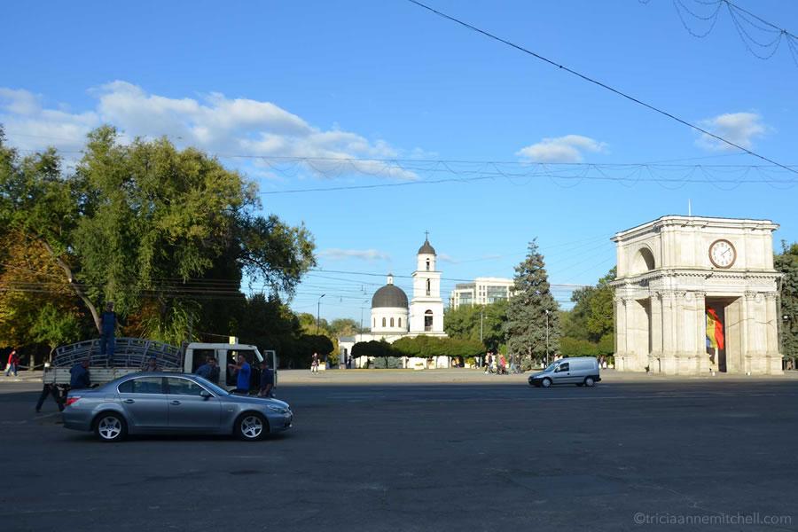 Cars drive past the Triumphal Arch in Moldova's capital city, Chisinau.