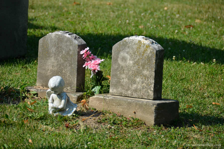 The 2 headstones of siblings Eddie and Josie Dimick in Chippiannock Cemetery in Rock Island, Illinois.