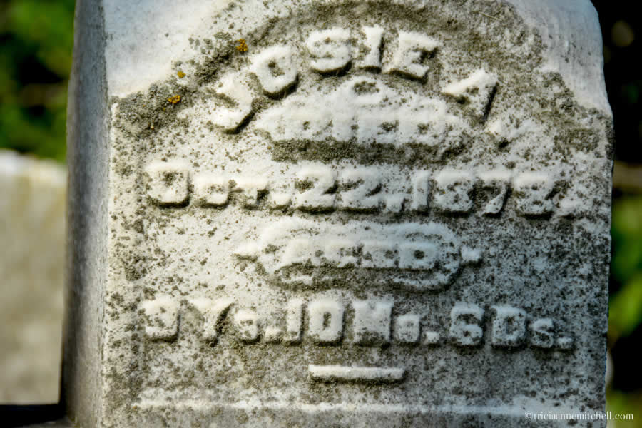 "The headstone of Josie Dimick reads: ""Josie A. died Oct. 22, 1878. Aged 9 years, 10 months, 6 days."""