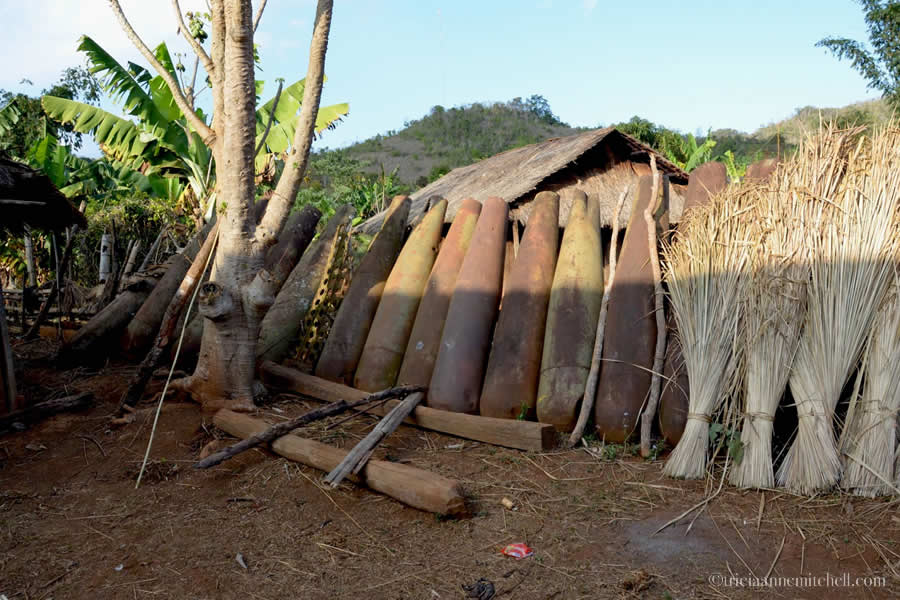 Bomb Village bomb casing fence Laos
