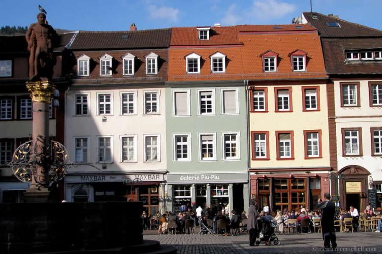 People stand on Marktplatz (Market Square), in the German city of Heidelberg.