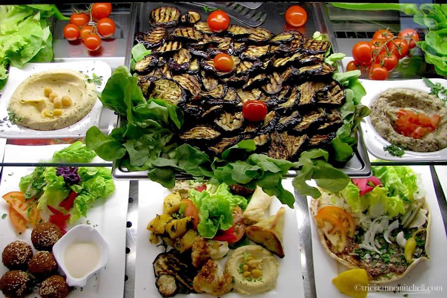 Sahara restaurant display window in Heidelberg, Germany features Falafel, Shwarma, Hummous