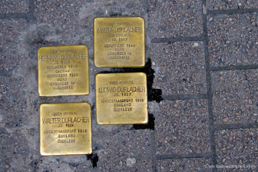 Four brass Stolpersteine (Holocaust memorials, which literally translate to