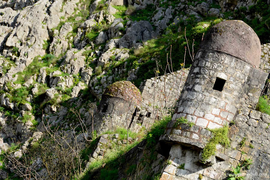 Two stone lookout towers of the Kotor Fortress in Montenegro.