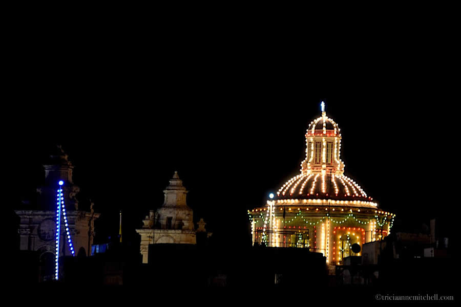 Colorful lights decorate a church dome for the Feast of the Immaculate Conception in Cospicua, Malta