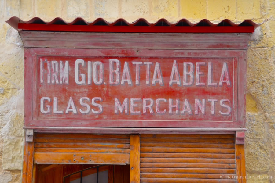 "Old Valletta Store Front Malta. The sign reads ""Glass Merchants"""