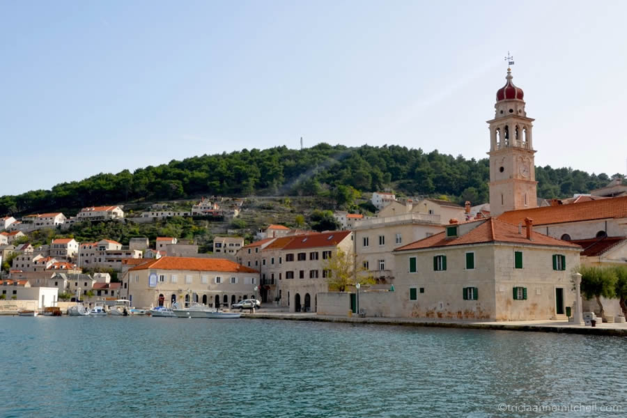 Pučišća's pretty skyline is characterized by limestone buildings, terracotta rooftops and the bell-tower of the Church of St. Jerolime.